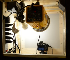 Photo of inside of photo booth with Canon G-9 Powershot camera, Alien Bee B-400 strobe, CFL modeling light and power strip.