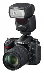 Speedlight mounted directly on camera. Runs on batteries, sets the shutter speed automatically, doesn't have a modeling light.